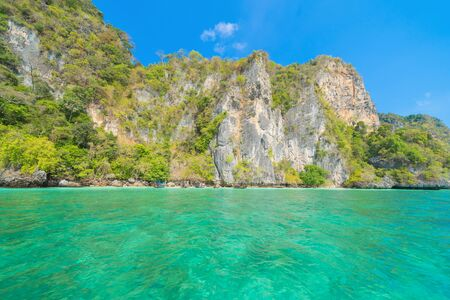 Phi Phi, Maya beach with blue turquoise seawater, Phuket island in summer season during travel holidays vacation trip. Andaman ocean, Thailand. Tourist attraction with blue cloud sky.