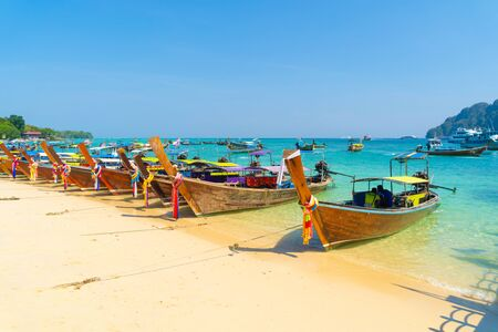 Boats in Phi Phi, Maya beach with blue turquoise seawater, Phuket island in summer season in travel holiday vacation trip. Andaman ocean, Thailand. Tourist attraction with blue sky. Nature landscape. Stok Fotoğraf