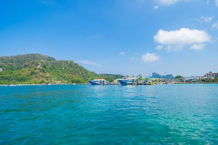 Boats in Phi Phi, Maya beach with blue turquoise seawater, Phuket island in summer season in travel holiday vacation trip. Andaman ocean, Thailand. Tourist attraction with blue sky. Nature landscape. 写真素材