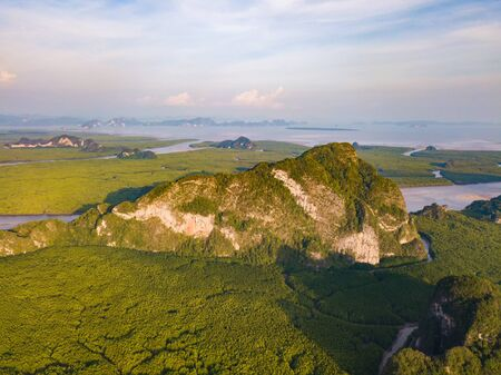 Aerial top view of Samet Nangshe and tropical green forest trees at sunset with Andaman sea in Phang Nga Bay in summer, Thailand in travel trip and holidays vacation. Natural landscape background. 写真素材