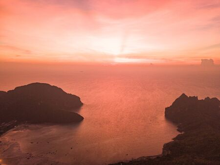 Aerial view of Phi Phi, Maya beach with blue turquoise seawater, mountain hills, and tropical green forest trees at sunset with Andaman sea in Phuket island in summer, Thailand in travel trip. Nature. 版權商用圖片
