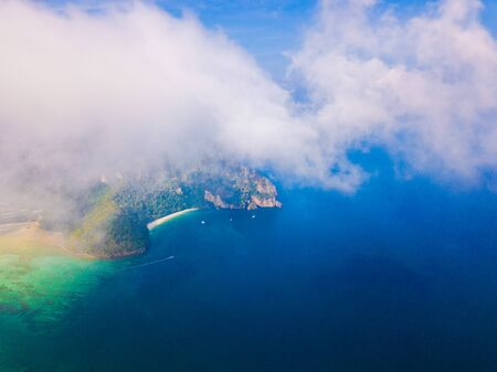 Aerial view of Phi Phi, Maya beach with blue turquoise seawater, mountain hills, and tropical green forest trees at sunset with Andaman sea in Phuket island in summer, Thailand in travel trip. Nature. 스톡 콘텐츠