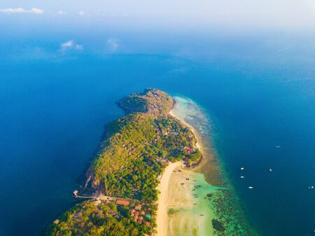Aerial view of Phi Phi, Maya beach with blue turquoise seawater, mountain hills, and tropical green forest trees at sunset with Andaman sea in Phuket island in summer, Thailand in travel trip. Nature. Stok Fotoğraf