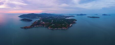 Aerial view of Promthep Cape viewpoint at sunset with Andaman sea in Phuket Island, tourist attraction in Thailand in travel trip and holidays vacation. Natural landscape wallpaper background. Stok Fotoğraf