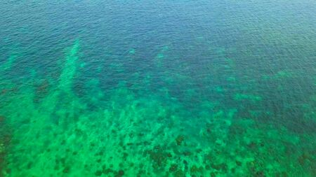 Aerial view of clear blue turquoise seawater, Andaman sea in Phuket island in summer season, Thailand. Water in ocean material pattern texture wallpaper background.