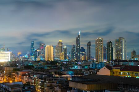 Aerial view of Sathorn district, Bangkok Downtown. Thailand. Financial district and business centers in smart urban city in Asia. Skyscraper and high-rise buildings at night.