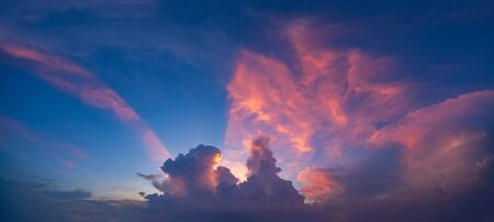 Sunset sky. Abstract nature background. Dramatic blue and orange, colorful clouds at twilight time. Stok Fotoğraf
