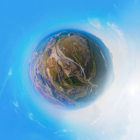 Little planet 360 degree sphere. Panorama of aerial view of machine excavator trucks dig coal mining or ore in quarry with mountain hills. Nature landscape background in factory industry. Environment