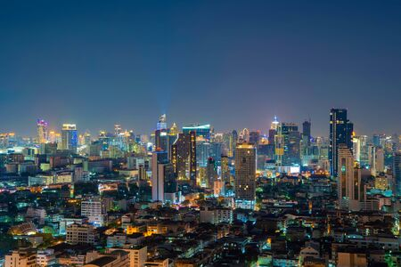 Aerial view of Sathorn district, Bangkok Downtown Skyline. Thailand. Financial district and business centers in smart urban city in Asia. Skyscraper and high-rise buildings at night.