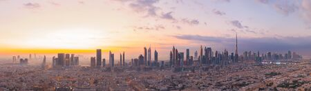 Aerial view of Dubai Downtown skyline, United Arab Emirates or UAE. Financial district and business area in smart urban city. Skyscraper and high-rise buildings at sunset. 스톡 콘텐츠