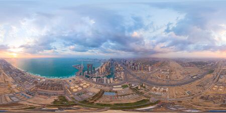360 panorama by 180 degrees angle seamless panorama of aerial view of Dubai Downtown skyline and highway, United Arab Emirates or UAE. Financial district in urban city. Skyscraper buildings at sunset. Imagens