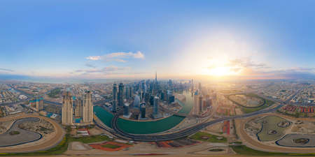 360 panorama by 180 degrees angle seamless panorama of aerial view of Dubai Downtown skyline and highway, United Arab Emirates or UAE. Financial district in urban city. Skyscraper buildings at sunset. 에디토리얼
