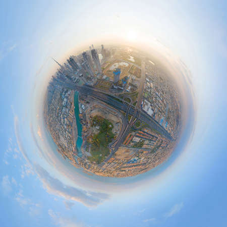 Little planet 360 degree sphere. Panorama of aerial view of Dubai Downtown skyline and highway, United Arab Emirates or UAE. Financial district in urban city. Skyscraper buildings at sunset. 에디토리얼