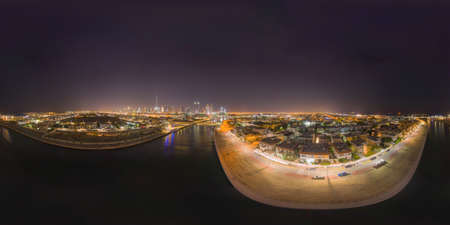 360 panorama by 180 degrees angle seamless panorama of aerial view of Dubai Downtown skyline and highway, United Arab Emirates or UAE. Financial district in urban city. Skyscraper buildings at night. 에디토리얼