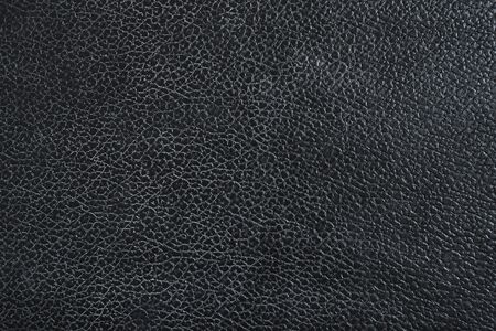 Black leather sofa, pattern surface texture. Close-up of interior material for design decoration background