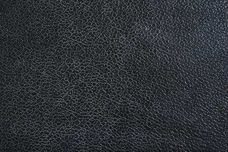 Canapé en cuir noir, texture de surface du motif. Gros plan du matériel intérieur pour fond de décoration design
