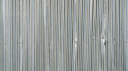 Metal steel strips. Rusty corrugated iron metal, Zinc steel wall, pattern texture background. Close-up of exterior architecture material for design decoration background. Standard-Bild