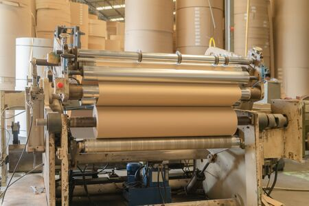 Paper tube cores, steel metal machine engine, technology manufacturer in operation process in industry manufacturing plant factory. Raw product equipment. Cardboard cargo in workshop warehouse Reklamní fotografie
