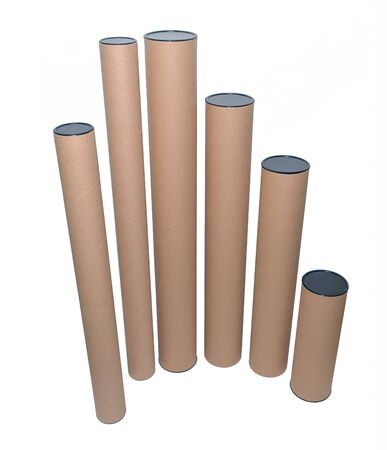 Paper tube cores, tissues isolated on white background, in industry manufacturing plant factory. Product material of brown paper rolls. Cardboard cylinder cargo in stock workshop storage warehouse. Imagens