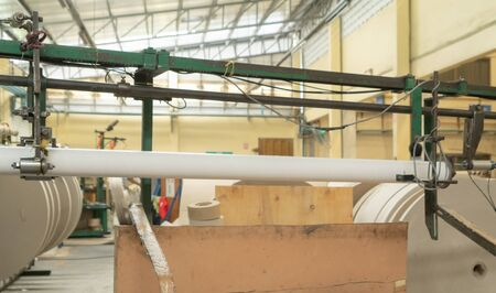 Paper tube cores, steel metal machine engine, technology manufacturer in operation process in industry manufacturing plant factory. Raw product equipment. Cardboard cargo in workshop warehouse