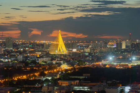 Aerial view of Rama 8 Bridge and Chao Phraya River in structure of suspension architecture concept, Urban city, Bangkok. Downtown area at night, Thailand.