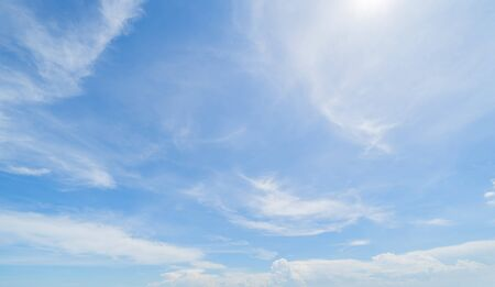 Clear blue sky with white fluffy clouds at noon. Day time. Abstract nature landscape background. Reklamní fotografie