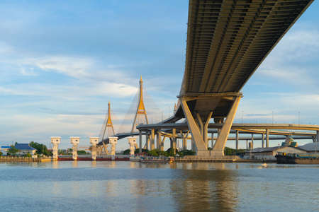 Bhumibol Bridge and Chao Phraya River in structure of suspension architecture concept, Urban city, Bangkok. Downtown area at sunset, Thailand. Reklamní fotografie