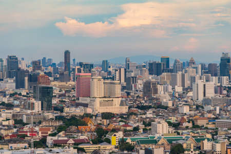 Aerial view of Phaya Thai district, Bangkok Downtown Skyline. Thailand. Financial district and business centers in smart urban city in Asia. Skyscraper and high-rise buildings at sunset.