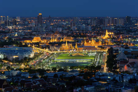 Temple of the Emerald Buddha, Grand palace, Wat Pho, Temple of Dawn, and Sanam Luang, Wat Phra Kaew, skyscraper buildings. Bangkok City in downtown at night, Thailand. Buddhist temple