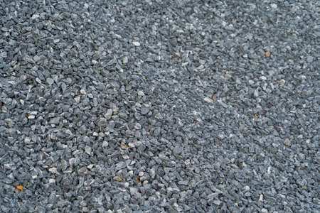 White granite gravel stones flooring pattern surface texture. Close-up of exterior material for design decoration background Banque d'images