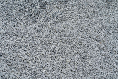 White granite gravel stones flooring pattern surface texture. Close-up of exterior material for design decoration background