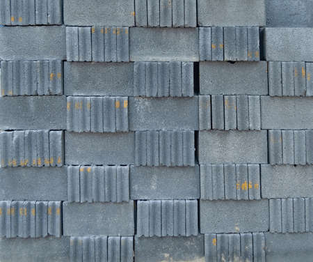 Stack of block bricks pattern texture background. Raw material for construction site project in industry concept. Cement structure metal steel in loft style. Reklamní fotografie