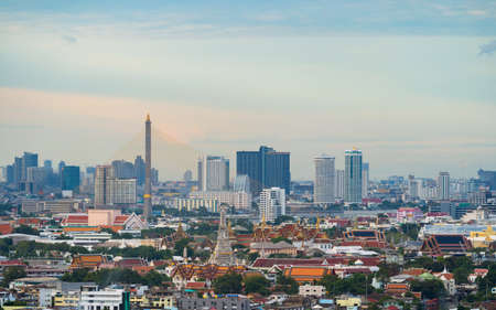 Aerial view of Rama 8 Bridge and Temple of Dawn or Wat Arun in Rattanakosin Island in architecture, Urban old town city, Bangkok skyline. downtown area, Thailand at sunset. 스톡 콘텐츠