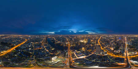 360 panorama by 180 degrees angle seamless panorama of aerial view of Bangkok Downtown Skyline. Thailand. Financial district in smart urban city in Asia. Skyscraper and buildings at night. Reklamní fotografie