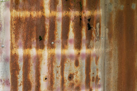 Metal steel strips. Rusty corrugated iron metal, Zinc steel wall, pattern texture background. Close-up of exterior architecture material for design decoration background.