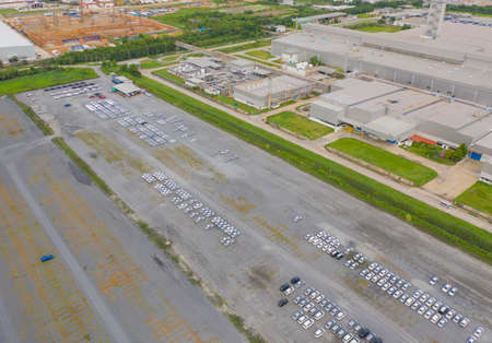 Aerial top view of new cars parking for sale stock lot row, dealer inventory import and export business commercial worldwide, Automobile and automotive industry distribution logistic global transport Standard-Bild