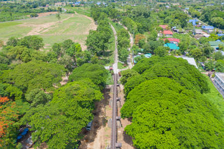 Aerial view of River Kwai Bridge with train rail way with Chao Phraya River, Tha Ma Kham, Mueang Kanchanaburi District, Thailand. Banco de Imagens - 157812014