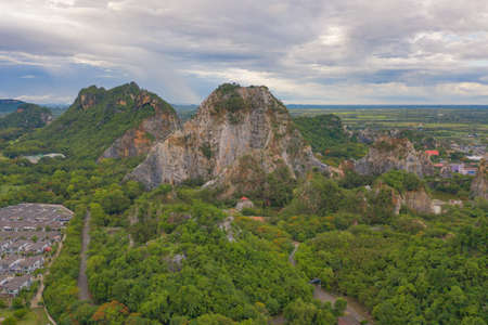 Aerial view of Khao Ngu Stone. National park with river lake, mountain valley hills, and tropical green forest trees at sunset in Ratchaburi, Thailand in travel trip. Natural landscape background. Banco de Imagens - 157812068
