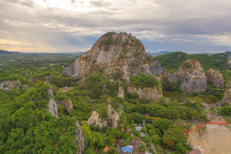 Aerial view of Khao Ngu Stone. National park with river lake, mountain valley hills, and tropical green forest trees at sunset in Ratchaburi, Thailand in travel trip. Natural landscape background.