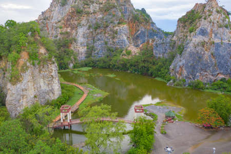 Aerial view of Khao Ngu Stone. National park with river lake, mountain valley hills, and tropical green forest trees at sunset in Ratchaburi, Thailand in travel trip. Natural landscape background. Banco de Imagens - 157812231