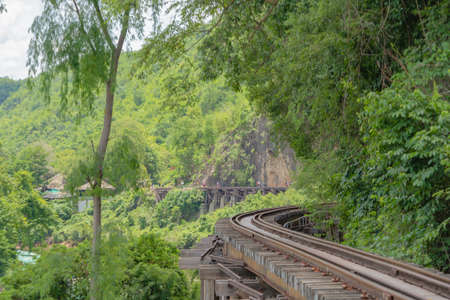 Empty train railway on River Kwai Bridge in Kanchanaburi town, Thailand in public transportation concept.