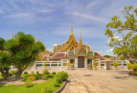 Golden pagoda at Temple of the Emerald Buddha in Bangkok, Thailand. Wat Phra Kaew and Grand palace in old town, urban city. Buddhist temple, Thai architecture. A tourist attraction