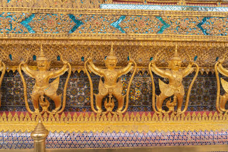 Garuda statue at Golden pagoda at Temple of the Emerald Buddha in Bangkok, Thailand. Wat Phra Kaew and Grand palace in old town, urban city. Buddhist temple, Thai architecture. Banco de Imagens