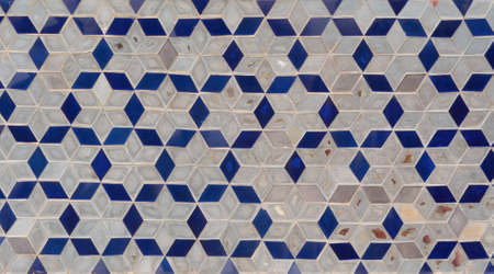 Colorful art grid square mosaic tiles wall pattern surface texture. Close-up of architecture interior material for design decoration background. Thai style