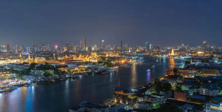Temple of the Emerald Buddha, Grand palace, Temple of Dawn, Bangkok City, Thailand. Wat Phra Kaew, and Chao Phraya River, skyscraper buildings. Downtown skyline. Buddhist temples at night. Banco de Imagens