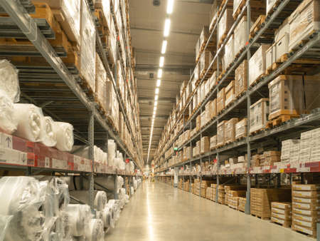 Interior of large warehouse retail store industry. Rack of furniture and home accessories store. Interior of cargo in ecommerce and logistic concept. Redactioneel