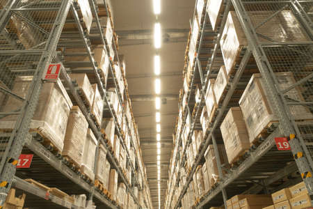 Interior of large warehouse retail store industry. Rack of furniture and home accessories store. Interior of cargo in ecommerce and logistic concept. Editorial