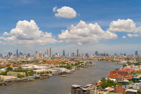 Temple of the Emerald Buddha, Grand palace, Temple of Dawn, Bangkok City, Thailand. Wat Phra Kaew, and Chao Phraya River, skyscraper buildings. Downtown skyline. Buddhist temples.