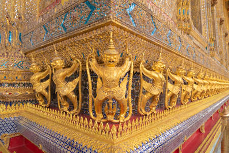 Garuda statue at Golden pagoda at Temple of the Emerald Buddha in Bangkok, Thailand. Wat Phra Kaew and Grand palace in old town, urban city. Buddhist temple, Thai architecture. Editorial