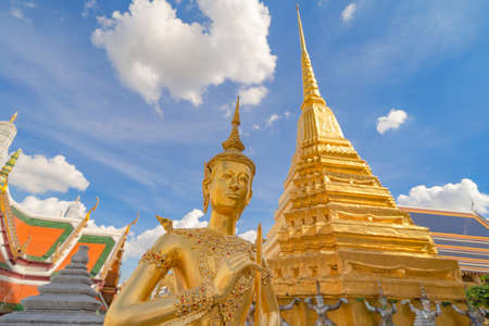 Kinnaree statue at Golden pagoda at Temple of the Emerald Buddha in Bangkok, Thailand. Wat Phra Kaew and Grand palace in old town, urban city. Buddhist temple, Thai architecture.